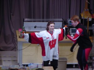 Girl in UW Hockey Jersey on stage