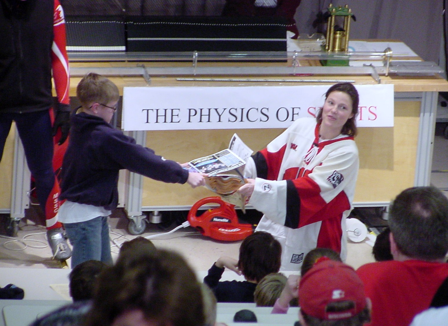 Boy and Girl pull on a book on stage