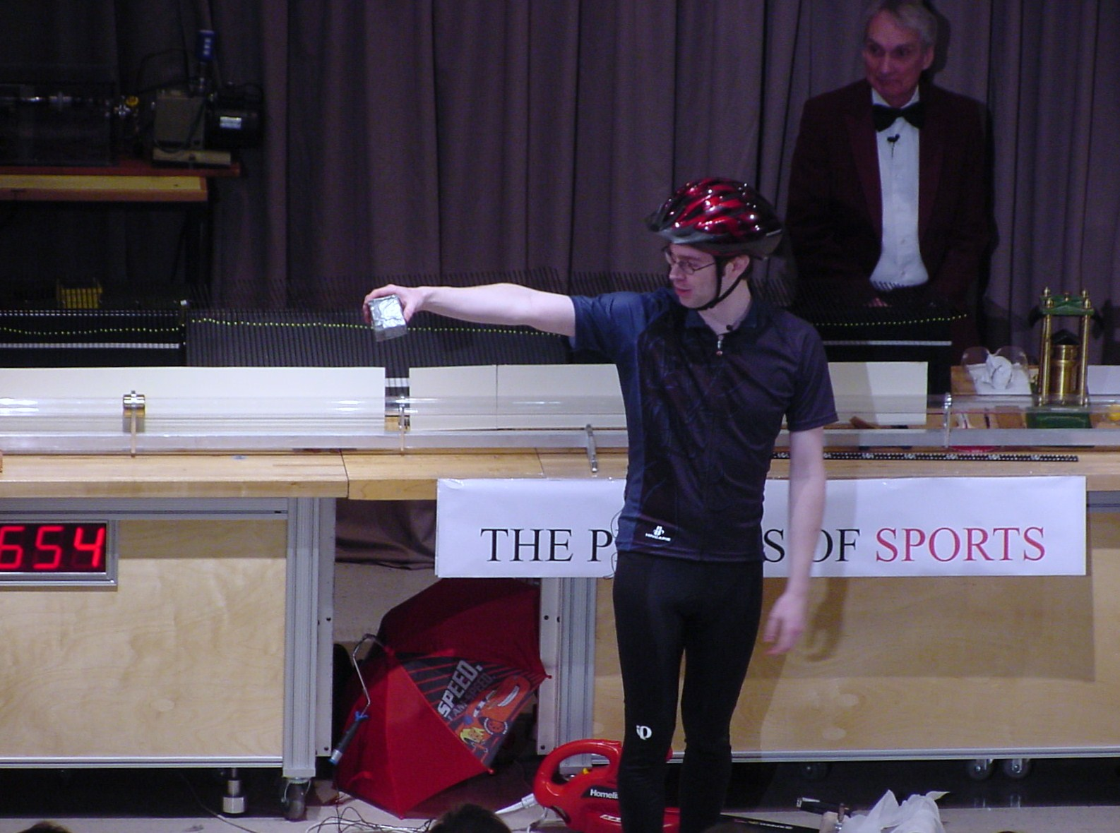 Man on stage doing an experiment