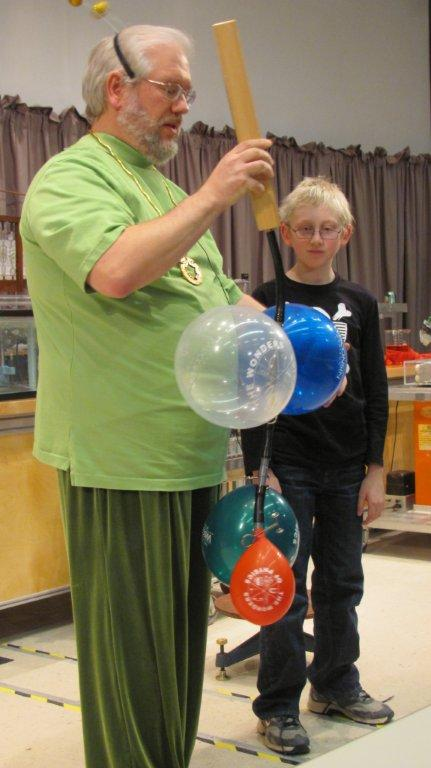 Man with balloons stuck to his shirt